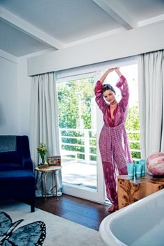 """At home with Miranda Kerr: Kerr had her 'Hampshire' bath installed in her bedroom. """"For me, the bedroom should be a romantic and luxurious space,"""" she explains,""""so integrating a freestanding bathtub with my rose-quartz crystal enabled me to achieve that in a simple way."""" The butterfly rug was custom made using 100 per cent natural materials."""