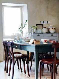 rustic dining room: good example of colored table with wooden chairs
