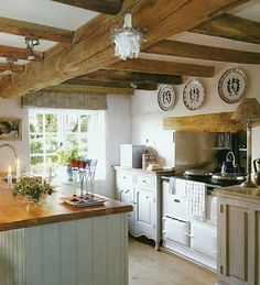 Beautiful European Country Kitchens {Decor Inspiration} Beautiful European country kitchen with rustic wood beamed ceiling and plates hung on wall.Beautiful European country kitchen with rustic wood beamed ceiling and plates hung on wall. New Kitchen, Kitchen Dining, Kitchen Decor, Kitchen Ideas, Kitchen Cabinets, Kitchen Designs, Rustic Cabinets, Kitchen Wood, Decorating Kitchen