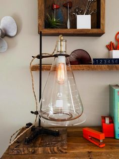 DIY Beaker Lamp: This one is for all you science-loving gals out there! Use a glass flask, an Edison bulb and a wooden base to create this funky lamp perfect for a sophisticated study space.
