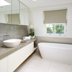 Chic neutral bathroom with built-in worktops and storage