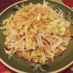 "Strangely good .. Napa Cabbage Salad..  I used 1/2 oil instead of the 3/4 the recipe calls for  1 tbs extra soy sauce and 1/3 of the oriental seasoning that came with the noodles..also adding more "" crunchy"" to the mix makes it taste better"