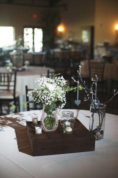 diy wedding center pieces. brances, queen anne's lace, cotton, river rocks, mason jars, candles