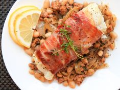 In this easy one-skillet meal, cod fish is wrapped in a layer of prosciutto, then pan-roasted until the prosciutto is crispy and the fish within is juicy and tender. Creamy cannellini beans cooked with crumbled chorizo and and shallots makes a flavorful accompaniment.
