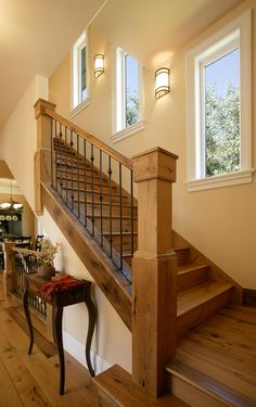 I like the windows going up the stairs. Maybe even a little shelf to be able to display picture frames in this space