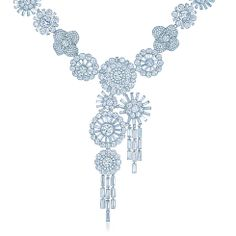 Tiffany & Co. -  Corsage necklace in platinum with round and baguette diamonds.