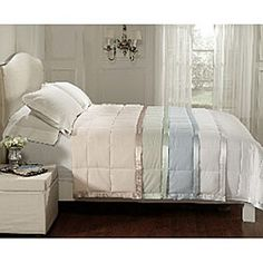 @Overstock.com - All Seasons Down Alternative Microfiber Blanket - Stay warm during a cold snap with this stylish down alternative blanket. The microfiber blanket looks and feels just like a down comforter, and its colored sateen strips add a decorative touch.  http://www.overstock.com/Bedding-Bath/All-Seasons-Down-Alternative-Microfiber-Blanket/4081645/product.html?CID=214117 $46.99