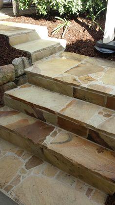 Sandstone Crazy Paving steps in Brisbane. Follow EcoBuilt Carpentry and Landscaping on Facebook