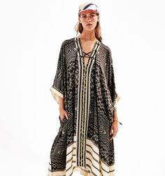 Model wears printed tunic in H&M Studio's spring 2016 collection