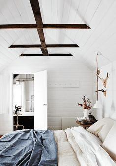 white bedroom vaulted ceiling