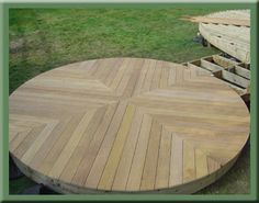Circular deck. could we build the foundation from landscaping stone and then lay the planks (wider) straight across with a dark stain?