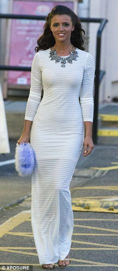 Glamorous: The former TOWIE star looked amazing in a white maxi dress with a large diamant...