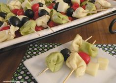 Tortellini Skewers---Cook tortellini, soak overnight in Italien dressing then put on skewers with cheese cubes, olives, grape tomatoes! Easy!