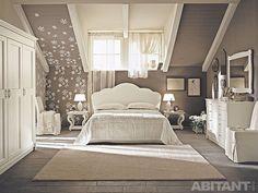 Белая спальня на мансардном этаже