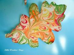 Shaving cream painted fall leaves -- it would be cool to paint these and then frame them