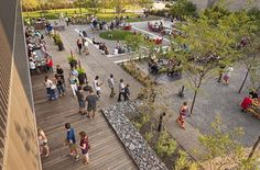 Surly Destination Brewery and Beer Gardens by HGA #landscapearchitecture #gabion #timber #deck