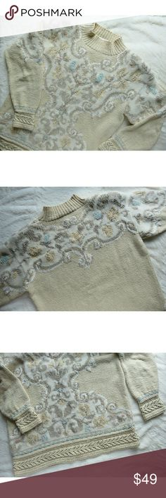 """Vintage Chunky Knit Ivory Embroidered Sweater Sm M Amazing vintage gem, wish it was my size! Gorgeous details--crochet knit around wrists and waist, fleur de lis /scroll/ floral allover design, embroidered details in pastel aqua blue, taupe, mauve pink, mock turtleneck. Background ivory color reminds me of egg nog. Ladies size Medium, measures lying flat approx 21"""" across chest & 26"""" from shoulder down to waist. Perfect oversized Small or Medium fit! Ramie/Cotton blend. Must have sweater for…"""