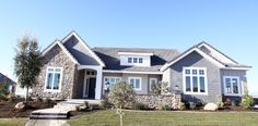 Parade of Homes 2013- I love the exterior of this home! Gray, white, stone...
