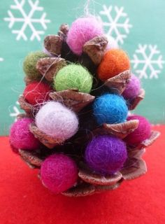 Make these beautiful pine cone Christmas trees. Collect pine cones on a family winter walk and when you get home spend a cosy afternoon decorating your little trees with mini pom poms. They look lovely hanging from your tree or lined up along your mantelpiece.