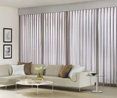 As an alternative to vertical blinds, try drapes with a matching custom Cornice. Shown are Pinch Pleat Drapes in Sheer Elegance with Cornice in Silk Dupioni. | The Shade Store