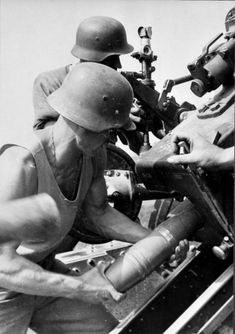 German Gunner reloading a 88 mm Cannon
