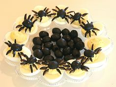 Great idea for Halloween Party Food - Spider Deviled Eggs made w/ black olives & hard boiled eggs cut in half. #recipe