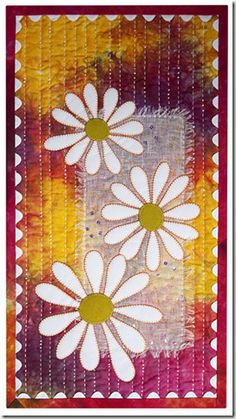 Susan Cleavand's Hippy Daisy wall quilt.   I love the hand-dyed fabric and the…