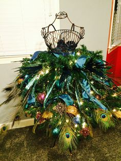 """Designed by C. Barnes of Lancaster, South Carolina. This was a """"tree"""" for my 13-year-old stepdaughter. She LOVED it and was quite proud of it. Also, after Christmas, she asked to please be able to keep the form in her room and has had fun incorporating it into her decor."""