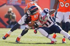 Denver Broncos wide receiver Eric Decker (87) is stopped New England Patriots cornerback Aqib Talib (31) during the first half. (Charlie Riedel/AP)