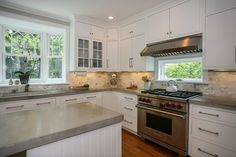 """Transitional Kitchen with Inset cabinets, Wolfe - 36"""" dual fuel range - 6 burners, Stone Tile, Glass panel, L-shaped"""