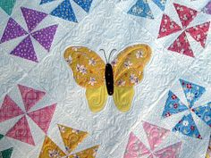 """""""You can see the micro-stippling in the pinwheel squares, plus more swirls to pull it all together."""" Laura J @ Butterfly Quilting"""
