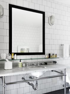 Love the vanity ... the marble with the tiles, dark mirror and glass shelve ...