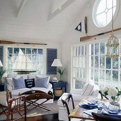 Nautical white and navy living room.  www.blackburninvestors.com