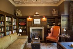 A 19th century chair covered in a vibrant orange Edelman leather takes center stage in this 1929 library that was restored and decorated by Ellsworth Ford.  Decorators: Robin Kencel and Carlene Safdie