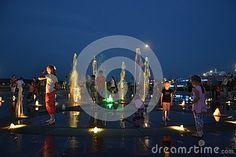 Happy children swimming in the fountain.City Penza.