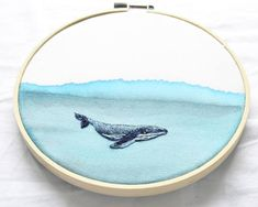 watercolor painted fabric with whale embroidery 14 cm in wooden hoop