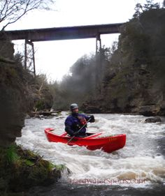 Whitewater canoeist on the Vermilion River, HardWaterSports.com