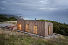 Jackson Clements Burrows Architects have designed the Moonlight Cabin, a small shelter that overlooks the ocean in Victoria, Australia. The architect's description Located on a windswept coast line, Moonlight Cabin is a place [. Cabin Design, Cottage Design, Modern House Design, Box Design, Design Ideas, Victorian Architecture, Interior Architecture, Sustainable Architecture, Interior Design
