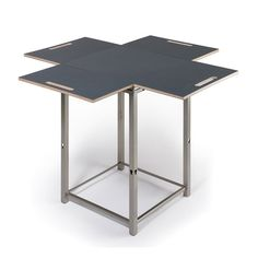 Laminated birch plywood and powder-coated metal come together in beautiful symmetry with this table. To take it from a side table to a 4-seat dining table, fold any of the 4 wings down or prop them up ...  Find the Fold & Pack Table, as seen in the Dining Tables Collection at http://dotandbo.com/category/furniture/tables/dining-tables?utm_source=pinterest&utm_medium=organic&db_sku=OFF0016