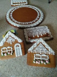 Gingerbread house parts and base beautifully decorated, ready to assemble: