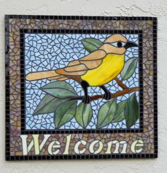 After my cats broke the stained glass panel, it became a mosaic welcome sign for the front of my house.