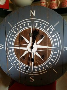 This clock is made from an old wooden wire spool. It has been sanded, stained and or painted to achieve a rustic look. No two spools are the same so looks will slightly differ. The clock is 32 inches. All of our clocks are made with a High Torque clock M Wooden Spool Tables, Cable Spool Tables, Wooden Cable Spools, Cable Spool Ideas, Cable Reel Table, Wooden Cable Reel, Wood Table, Deco Marine, Spool Crafts