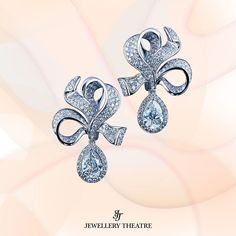 These elegant new #earrings from our Nobility collection are made from 18K white #gold and feature 2 pear shaped #diamonds at 1.04ct complemented by 310 diamonds at 1.21ct. #jewellerytheatre #diamondearrings #bowearrings