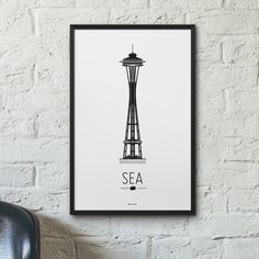 The Seattle Icon poster features the Space Needle, a 605-foot observation tower in Seattle, Washington. Once the tallest structure west of the Mississippi River, it was originally built for the 1962 W