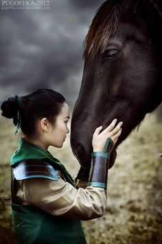 MULAN...whenever I see a picture like this of a real life Disney princess I can't help think of the Mulan in Once Upon a Time, not ones like in this picture.