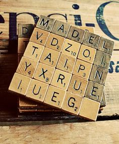 DIY scrabble coasters.  Here is one with the tutorial, the other one i had was just a picture.  Do pinterest right.  It makes a difference!