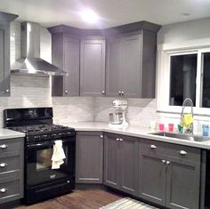 Image result for white cabinets grey walls stainless steel bronze