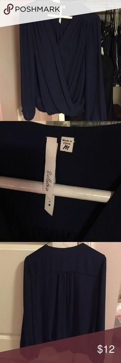 Navy Blue crossover blouse.  Banded hem.  Sz M. Bellatrix Navy Blue Crossover blouse.  Elastic banded hem.  Sz M.  Never worn.  Very flattering on! Bellatrix Tops Blouses