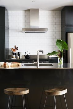 The kitchen has the essence of urban loft living: modern and industrial hardware.
