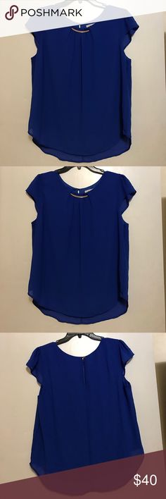 Offers accepted 🦋 gorgeous blue top Gorgeous royal blue top with a gold accent. Perfect for work or a night out meraki Tops Blouses